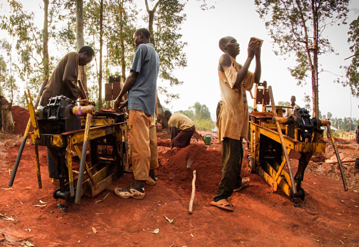 Workers making clay bricks