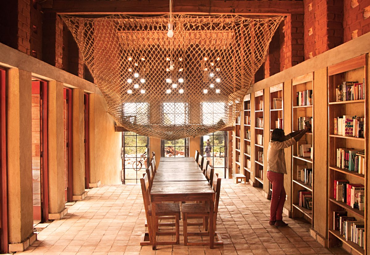 Traditional African clay brick building designed by Brussels architects