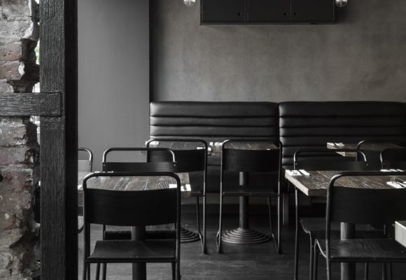 Dark, charred materials create a potent atmosphere at London restaurant Cattle & Co